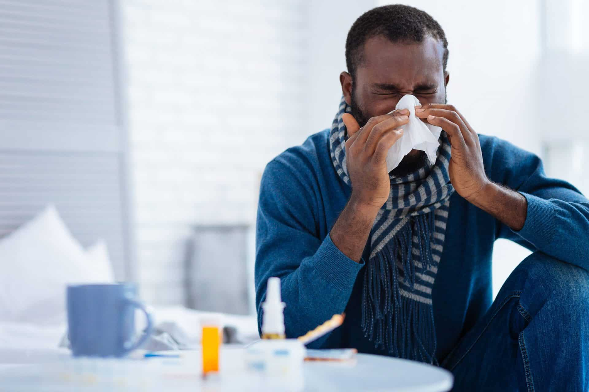 Man-with-cold-or-flu-blowing-nose