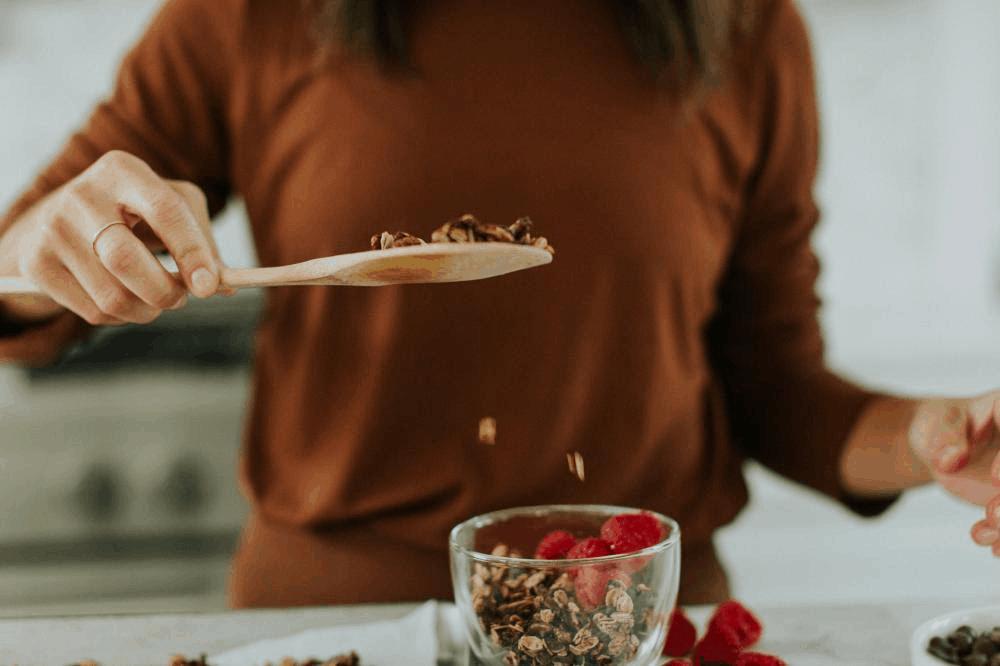 Woman-making-homemade-granola-from-recipe