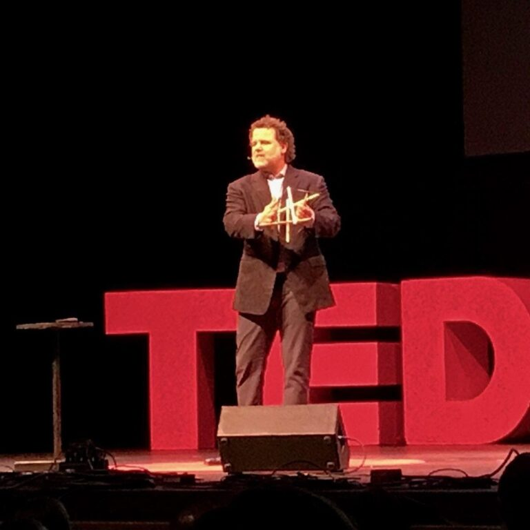 Dr. Haase giving a TED Talk while holding a tensegrity structure