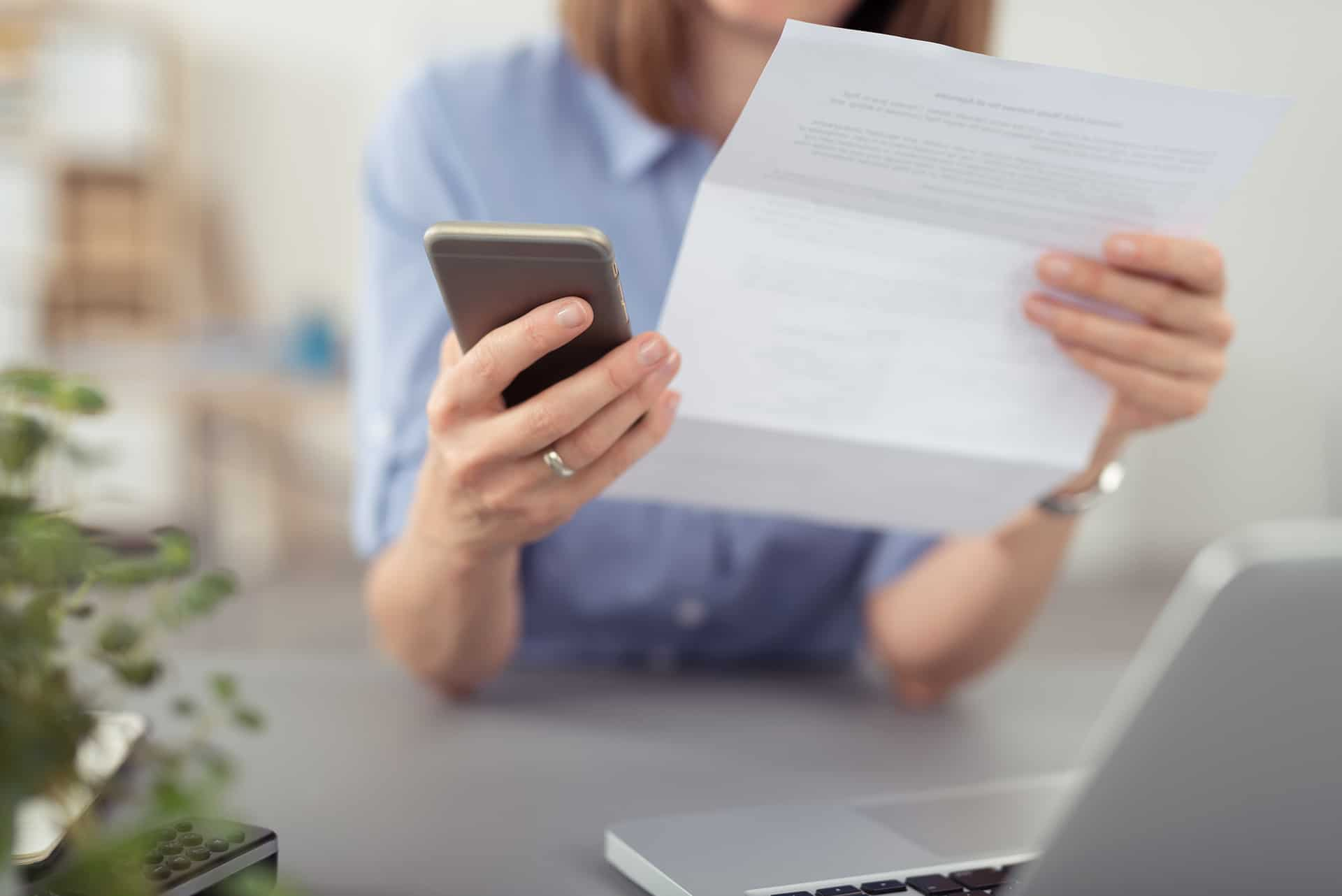 Woman-reading-insurance-statement