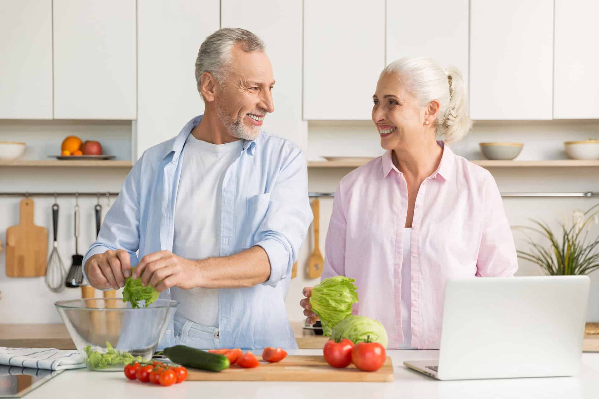 Mature-couple-preparing-healthy-meals