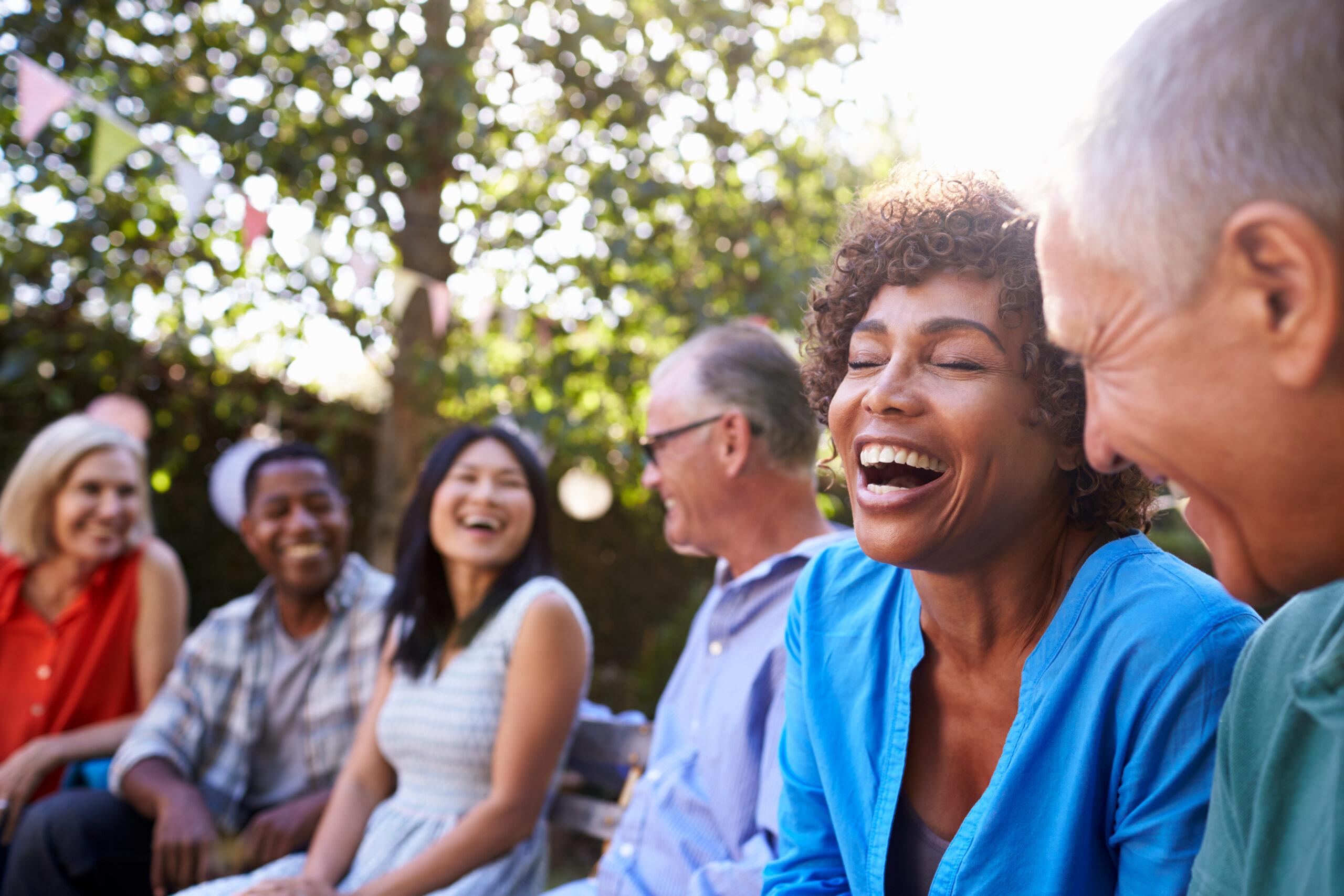Seniors-laughing-outside-enjoying-community-connection